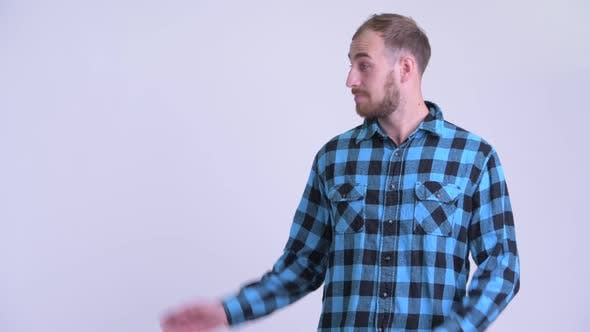 Thumbnail for Happy Bearded Hipster Man Talking While Showing Something