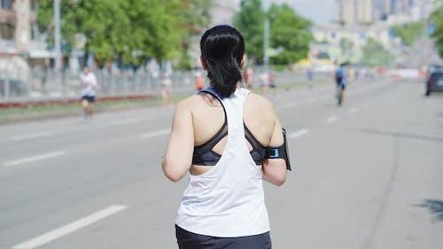 Slow Motion Woman Running Street Race