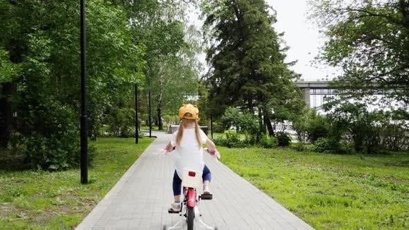 Thumbnail for Little Cute Girl Enjoying Riding Her Bike Outdoors
