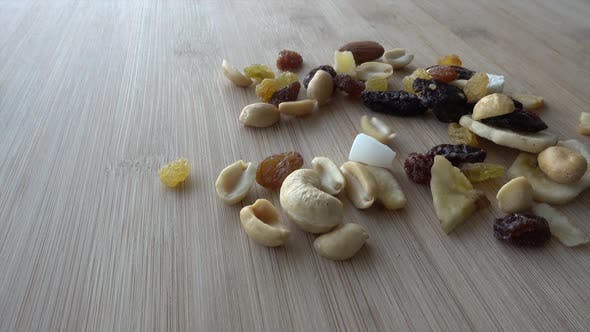 Cover Image for Droping Dried Fruits on Wood Table