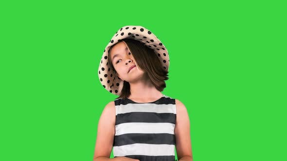Smiling Little Asian Girl Wearing Sunglasses Ready To Go for a Walk on a Green Screen Chroma Key