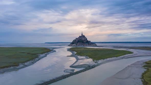 Le Mont Saint Michel France Castle in Ocean Sunrise Night to Day Hyperlapse Aerial Forward