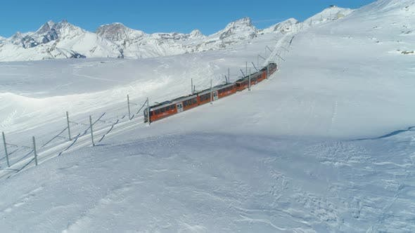 Thumbnail for Cog Railway Train in Sunny Winter Day. Swiss Alps. Switzerland. Aerial View
