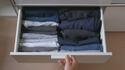 Open the Drawer with Clothes