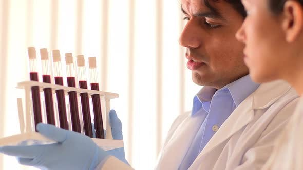 Thumbnail for Mexican scientists going over blood test samples