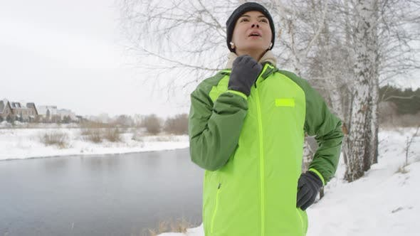 Thumbnail for Beautiful Woman Catching her Breath after Jogging in Winter