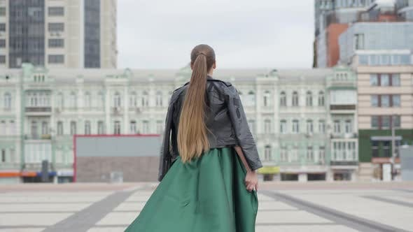 Thumbnail for Beautiful Cute Girl in a Stunning Evening Green Dress Cheerful and Happy Walking and Playfully