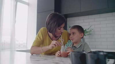 Mother and Son Drink the Juice of the Tubes
