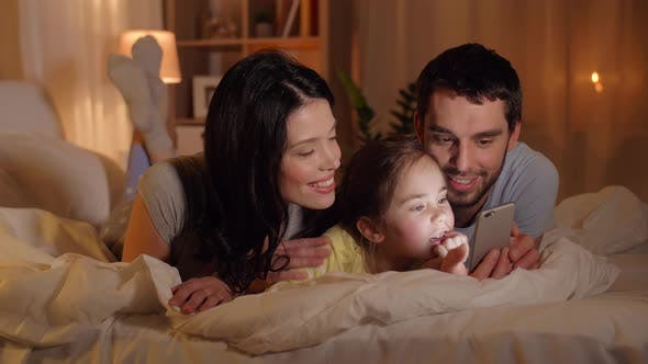 Thumbnail for Happy Family with Smartphone in Bed at Home 16