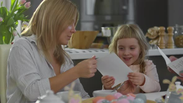 Cover Image for Woman Giving Easter Cards to Daughter and Grandma