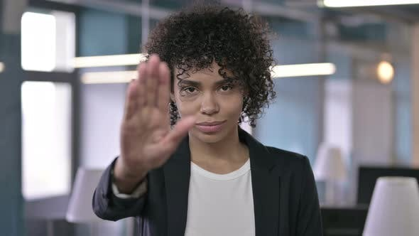 Thumbnail for Portrait of African Businesswoman Asking To Stop By Hand Gesture
