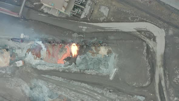 Thumbnail for Pour Molten Slag From the Diesel Locomotive Tank at a Metallurgical Plant. Aerial View