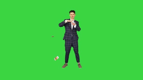 Thumbnail for Young Happy Businessman Dancing and Throwing Money on a Green Screen, Chroma Key.