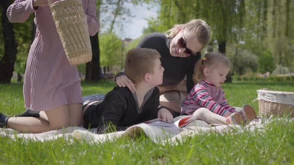 Thumbnail for Portrait Pretty Family Outdoor Recreation. Two Beautiful Young Mothers and Their Children at a