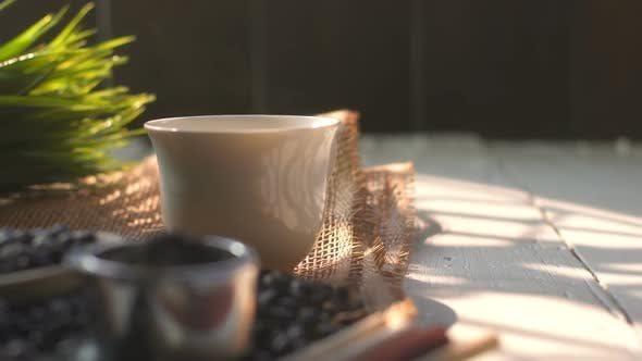 Thumbnail for Coffee With Burlap On Wooden Desk
