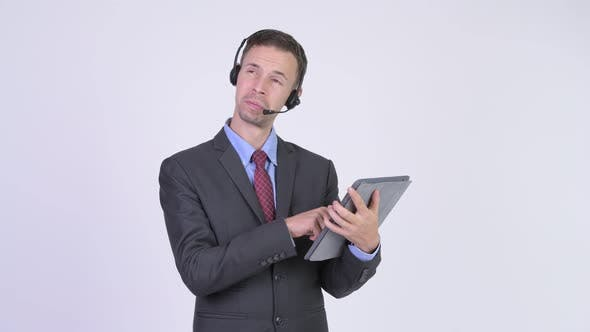 Thumbnail for Happy Businessman As Call Center Representative Using Digital Tablet