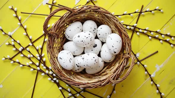 Thumbnail for Whole Chicken Eggs in Brown Wicker Basket. The Concept of Easter Holidays