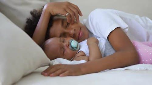 Cute African Siblings Sleep Together