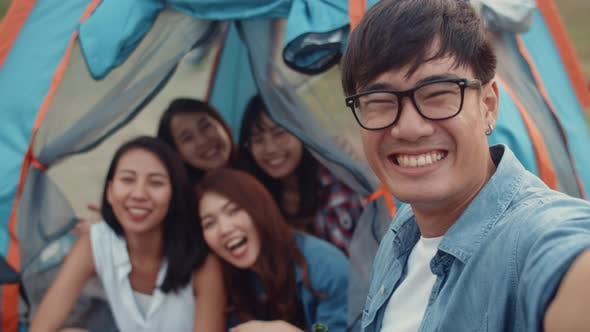Group of Asia best friends teenagers take selfie picture and video with phone camera enjoy happy.