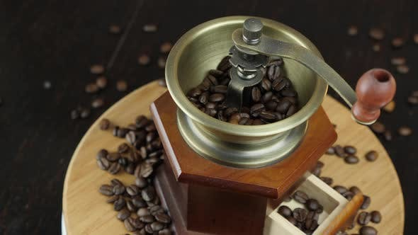 Vintage wood coffee grinder with coffee beans
