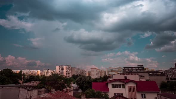 Thumbnail for Storm Rainy Dramatic Clouds Moving Fast Over a Residential Area in City