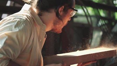 Carpenter checking wood