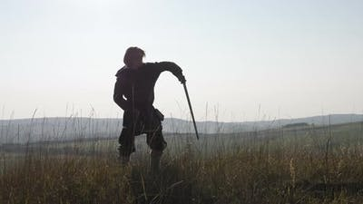 Man training with a sword