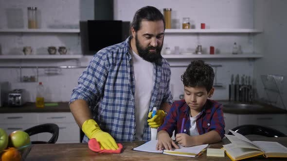 Thumbnail for Busy Single Dad Cleaning House While Son Studying