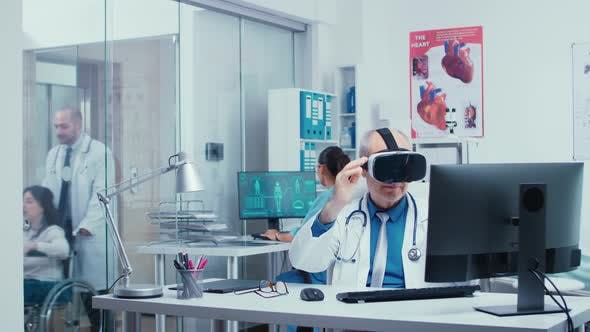 Senior Physician Using VR Glasses in Modern Private Clinic