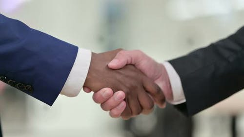 African Businessman Shaking Hands with Businessman