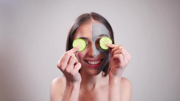 Thumbnail for Funny Girl Hiding Eyes Behind Cucumber Slices
