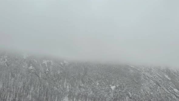 Thumbnail for Heavy snow falls over the top of Veliki Krs mountain 4K drone footage
