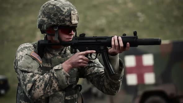 Thumbnail for Soldier in a helmet and sunglasses shooting an MP5