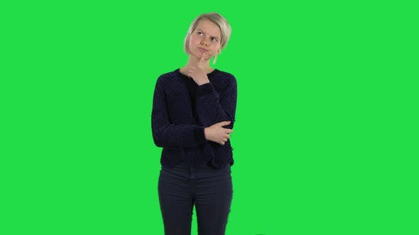 Thumbnail for Blonde Girl with Creative Haircut Is Thinking on a Green Screen