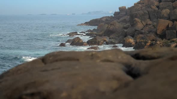 Thumbnail for Ocean Bay with Steep Rocky Shore and Reefs Slow Motion