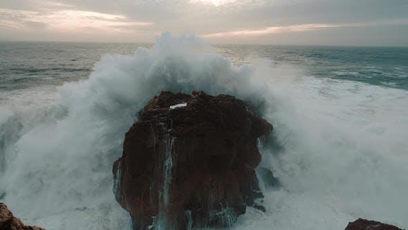 Sea Wave Breaks On Beach Rocks Landscape