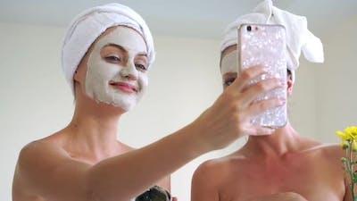 Beautiful Woman Having a Facial Treatment at Spa