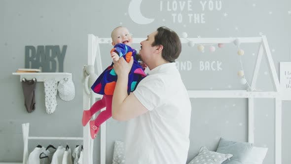 Thumbnail for Loving Father Playing with Joyful Baby at Home