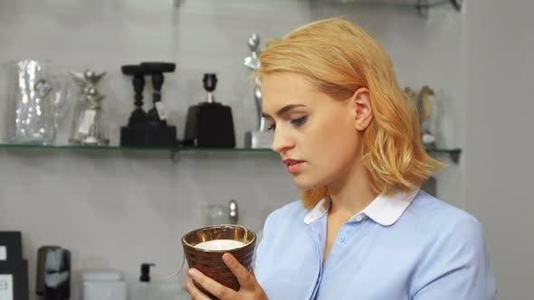 Thumbnail for The Girl Evaluates a New Mug