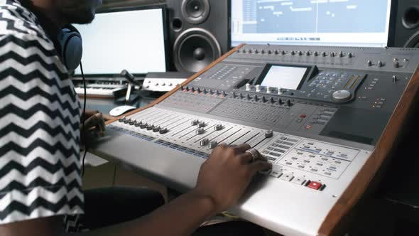 Thumbnail for Audio Engineer Working at Recording Studio