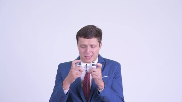 Thumbnail for Young Handsome Businessman Playing Games