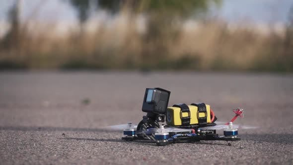 Cover Image for FPV Racing Drone Takes Off From the Asphalt Surface