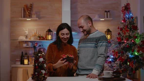 Man Giving Present to Woman for Christmas Celebration
