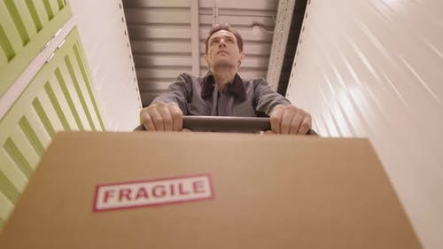 Pushing Trolley with Fragile Package