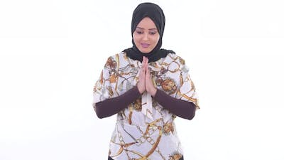 Happy Young Beautiful African Muslim Woman Bowing with Respect