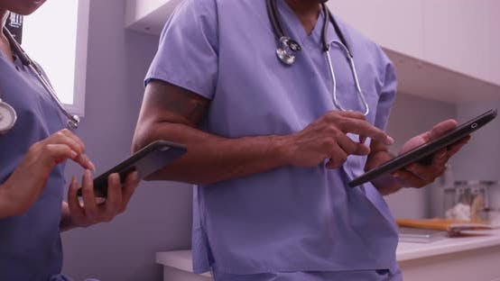 Thumbnail for Doctors using devices in the office