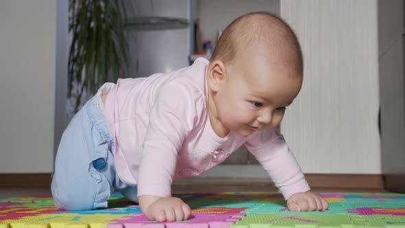 Happy Baby Crawls in the Room