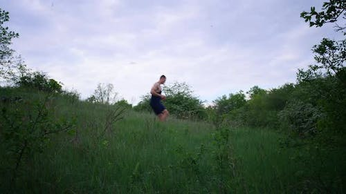Athletic Man Running on Meadow