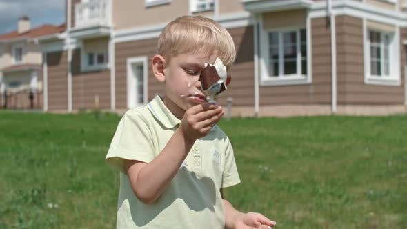 Thumbnail for Boy Eating Melting Ice Cream