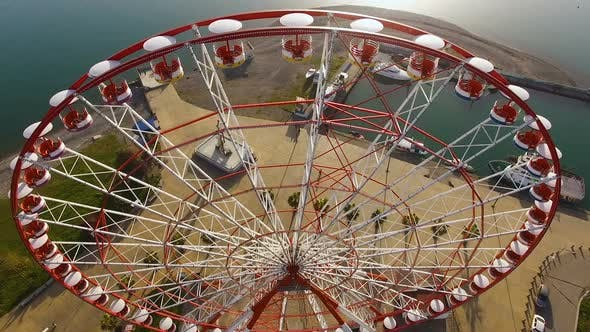 Cover Image for Gentle Morning Sunlight Through Metallic Construction of Ferry Wheel at Seaside